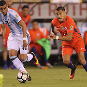EAST RUTHERFORD, NEW JERSEY - JUNE 26: Alexis Sanchez #7 of Chile is action watched by Ramiro Funes Mori #13 of Argentina during the Argentina Vs Chile Final match of the Copa America Centenario USA 2016 Tournament at MetLife Stadium on June 26, 2016 in East Rutherford, New Jersey. (Photo by Tim Clayton/Corbis via Getty Images)