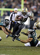 New Orleans Saints running back Khiry Robinson (29) leaps and eludes the outstretched arms of Philadelphia Eagles outside linebacker Connor Barwin (98) and an Eagles teammate as he runs to the Eagles 15 yard line in the fourth quarter during the NFL NFC Wild Card football game against the Philadelphia Eagles on Saturday, Jan. 4, 2014 in Philadelphia. The Saints won the game 26-24. ©Paul Anthony Spinelli