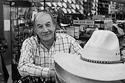 Western Wear. A local proprietor stands for a portrait in his store, Las Vegas, New Mexico.