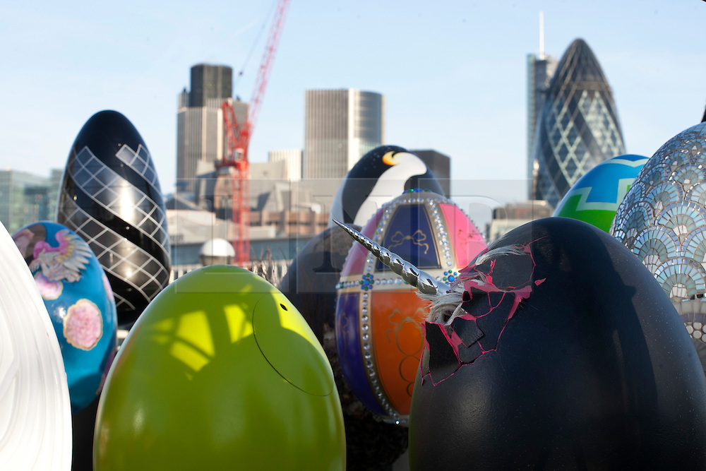 © licensed to London News Pictures. London, UK 20/02/2012. 30 special designed eggs are positioned together by Elephant Family and Action for Children charities for a photo opportunity in front of Tower Bridge. Photo credit: Tolga Akmen/LNP