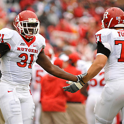 Sep 26, 2009; College Park, MD, USA; Rutgers defensive end George Johnson (31) high fives offensive lineman Art Forst (77) after a successful extra point attempt during the first half of Rutgers' 34-13 victory over Maryland in NCAA college football at Byrd Stadium.