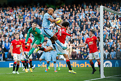 Vincent Kompany of Manchester City heads a shot as David De Gea and Marouane Fellaini of Manchester United challenge - Photo mandatory by-line: Rogan Thomson/JMP - 07966 386802 - 02/11/2014 - SPORT - FOOTBALL - Manchester, England - Etihad Stadium - Manchester City v Manchester United - Barclays Premier League.