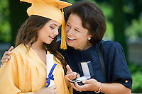Graduate Receiving Gift from Grandmother