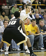 26 NOVEMBER 2007: Iowa guard Jake Kelly (32) looks for an open player while being guarded by Wake Forest guard Ishmael Smith (10) in Wake Forest's 56-47 win over Iowa at Carver-Hawkeye Arena in Iowa City, Iowa on November 26, 2007.
