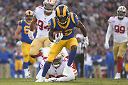 Dec 30, 2018; Los Angeles, CA, USA; Los Angeles Rams wide receiver Brandin Cooks (12) runs with the football past San Francisco 49ers defensive tackle D.J. Jones (93) at Los Angeles Memorial Coliseum. The Rams defeated the 49ers 48-31.  (Robin Alam/Image of Sport)