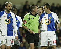 Photo: Aidan Ellis.<br /> Blackburn Rovers v Tottenham Hotspur. The Barclays Premiership. 19/11/2006.<br /> Blackburn's Andre OOijer confronts referee Phil Dowd after he sends off Tugay