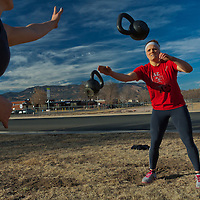 Quinn Megargel plays Kettlebell catch with Venassa, Crossfit image, picture, photo, photography of health, elite, exercise, training, workouts, WODs, taken at Progressive Fitness CrossFit,Colorado Springs, Colorado, USA.