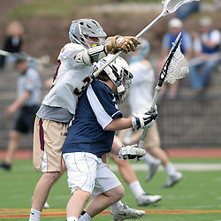 Staff photos by Tom Kelly IV<br /> Haverford's Shane McBride (32) tries to strip the ball from Episcopal's goalie Colin Reder (1) during the Episcopal Academy at the Haverford School boys lacrosse game on Tuesday, April 7, 2015.