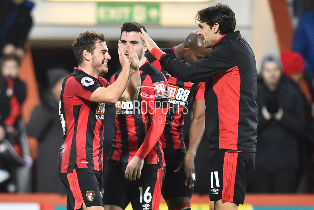 Ryan Fraser (24) of AFC Bournemouth celebrates the 2-1 win at full time with Charlie Daniels (11) of AFC Bournemouth during the Premier League match between Bournemouth and Everton at the Vitality Stadium, Bournemouth, England on 30 December 2017. Photo by Graham Hunt.