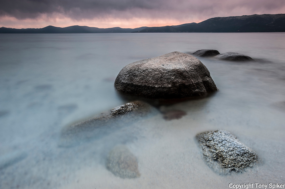 """Thunderbird Beach Sunset 6"" - A long exposure photograph of a clearing storm from Thunderbird Beach on the Eastern Shore of Lake Tahoe"