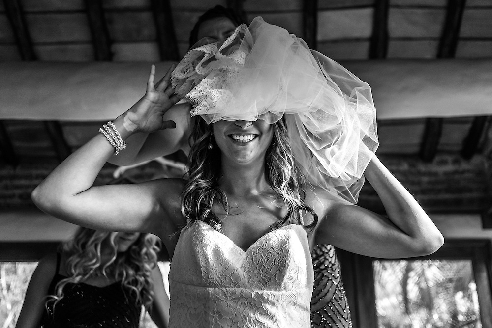 Robin showing off her best wedding accessory during her beautiful day at Las Caletas, Puerto Vallarta. Photo by: Melissa Suneson.