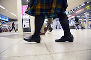 low angle view of female commuter at Tokyo Shibuya train station