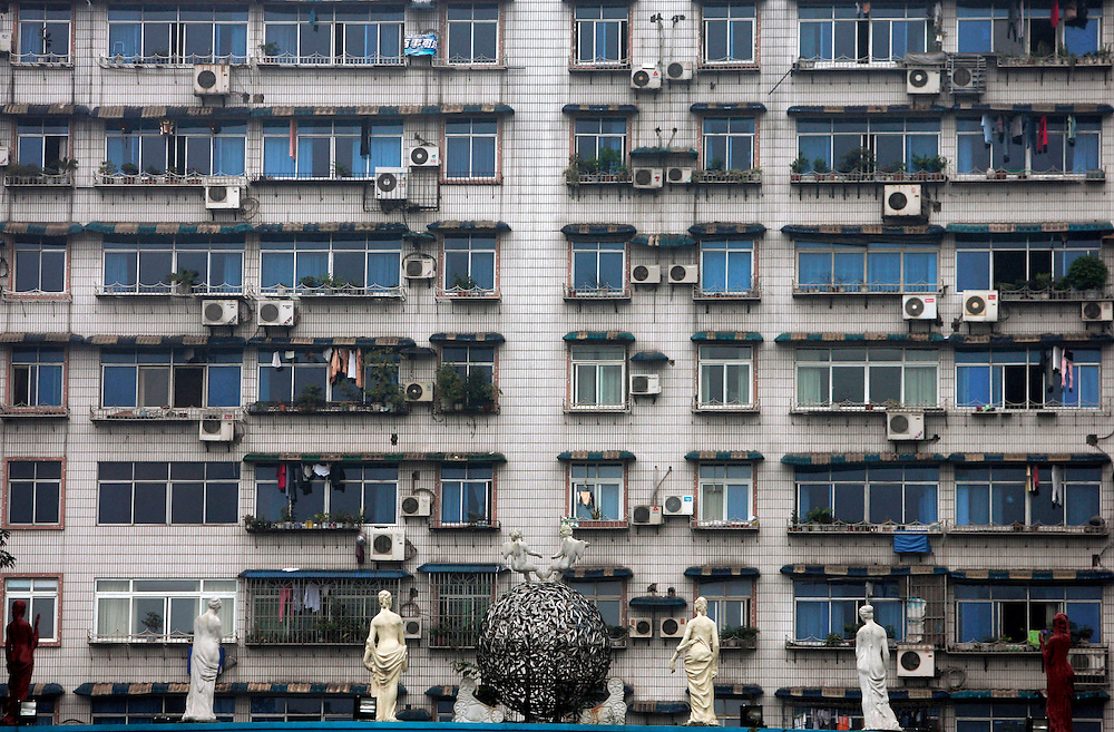 Statues line up the entrance to an apartment building in Chongqing, China, Friday, Oct. 31, 2008. Block after city block, towers of concrete, steel and glass fill the skyline teeming and congested, the intensely urban landscapes of China's biggest cities show a glimpse of what the future will hold for the rest of the country. In the sprawling megacities of Beijing, Shanghai and Chongqing, where populations exceed 10 million people, extreme urban density means that the number of people living within a few square blocks here is equal to the population of entire mid-size U.S. cities. China's urban population soared to 607 million people last year _ nearly equaling the 700 million living in the countryside. The country's headlong plunge toward urbanization continues unabated as tens of millions of migrants from the countryside flood to cities in search of money, jobs and other opportunities.