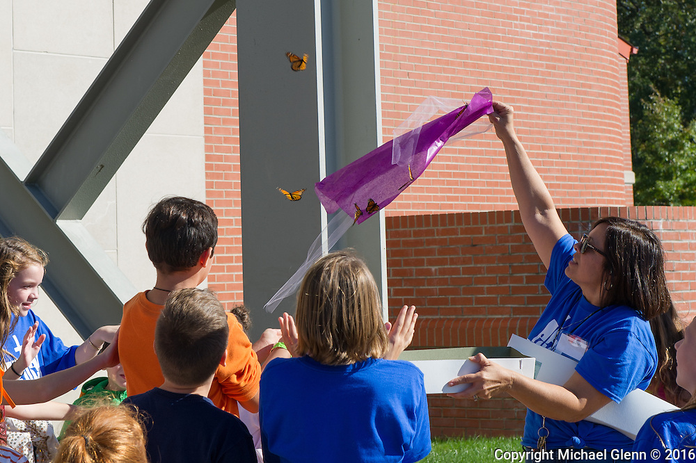 15 Oct. 2016 Forked River USA / Monarch Butterflies are released to the skies to celebrate the joy that 10 years of the new parish have brought. St Pius X celebrates it's 10th year in their new church with a festival open to all  /  Michael Glenn  / Glenn Images