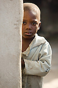 Boy behind a wall. Northern Ghana, Thursday November 13, 2008.