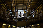 A prison officer escorts an inmate to his cell. HMP Wandsworth, London, United Kingdom