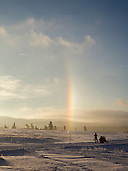 Snowmobiler watching a sundog, Yellowstone National Park