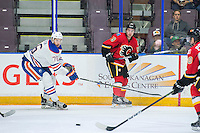 PENTICTON, CANADA - SEPTEMBER 17: Ben Betker #76 of Edmonton Oilers stick checks Dillon Dube #59 of Calgary Flames on September 17, 2016 at the South Okanagan Event Centre in Penticton, British Columbia, Canada.  (Photo by Marissa Baecker/Shoot the Breeze)  *** Local Caption *** Dillon Dube; Ben Betker;