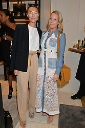 Left to right, ROBERTA BENTELER and ALICE NAYLOR-LEYLAND at a lunch hosted by Alice Naylor-Leyland and Tamara Beckwith in celebration of the Coach 2015 collection held at Coach, New Bond Street, London on 18th September 2014.