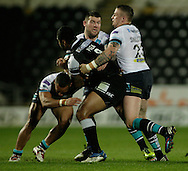 Mickey Paea (centre) of Hull Football Club is tackled by Paul Aiton, Carl Ablett &amp; Brad Singleton of Leeds Rhinos during the First Utility Super League match at KC Stadium, Hull<br /> Picture by Richard Gould/Focus Images Ltd +44 7855 403186<br /> 12/09/2014