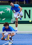 (R) Mate Pavic & (L) Marin Draganja both of Croatia compete in double match during the BNP Paribas Davis Cup 2014 between Poland and Croatia at Torwar Hall in Warsaw on April 5, 2014.<br /> <br /> Poland, Warsaw, April 5, 2014<br /> <br /> Picture also available in RAW (NEF) or TIFF format on special request.<br /> <br /> For editorial use only. Any commercial or promotional use requires permission.<br /> <br /> Mandatory credit:<br /> Photo by © Adam Nurkiewicz / Mediasport