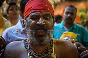 Jan. 24, 2016 - Kuala Lumpur, Batu Caves, Malaysia - <br /> <br /> Thaipusam Festival in Kuala Lumpur<br /> <br /> A Hindu devotee pierced his tongue with metal skewers to take part of the Thaipusam procession in the Batu Caves. To mark this day, Hindus devotees pierce different part of their body with various metal skewers and carry pots of milk on their heads along couple of kilometers to celebrate the honor of Lord Subramaniam (Lord Murugan) in the Batu Caves, one of the most popular shrine outside India and the focal point to celebrate the Thaipusam Festival in Malaysia..Thaipusam is an annual Hindu festival, observed on the day of the full moon during the Tamil month of Thai, it is also a public holiday for many people.<br /> ©Exclusivepix Media