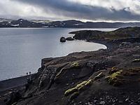 Lake Kleifarvatn at Reykjanes Peninsula. People by the border of the Lake. Iceland.