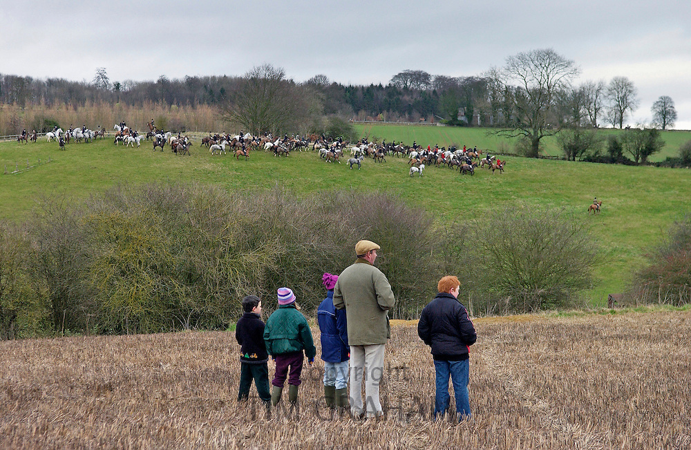 A family gather to watch the Heythrop New Year's Day Hunt as it crosses the Stow-on-the-Wold fields in Oxfordshire