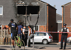 """© Licensed to London News Pictures. 07/08/2018. London, UK. Police at the scene of a house fire in Deptford, east London, in which a 7 year-old boy has died. Six fire engines were called to a """"suspicious"""" fire in the early hours of Tuesday morning. Photo credit: Rob Pinney/LNP"""
