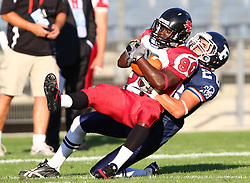 09.07.2011, UPC Arena, Graz, AUT, American Football WM 2011, Group B, France (FRA) vs Canada (CAN), im Bild Alexandre Marquignon (France, #26, DB ) sacks Jahmeek Murray (Canada, #80, R)  // during the American Football World Championship 2011 Group B game, France vs Canada, at UPC Arena, Graz, 2011-07-09, EXPA Pictures © 2011, PhotoCredit: EXPA/ T. Haumer