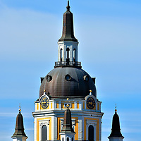 Dome on Church of Catherine in Stockholm, Sweden <br /> Katarina kyrka's magnificent dome, several spires and bright yellow color are clearly visible high on a hill in Södermalm from the shores of Strömmen, the waterway leading into central Stockholm.  The namesake for the original Church of Catherine, which was built in the late 17th century, was the mother of King Charles X.  It has been destroyed twice by fires, first in 1723 and then again in 1990. The current baroque appearance was rebuilt in 1995.