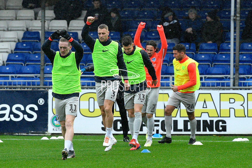 Ronan Curtis (11) of Portsmouth, Lee Brown (3) of Portsmouth and James Bolton (13) of Portsmouth  warming up ahead of the EFL Sky Bet League 1 match between Bristol Rovers and Portsmouth at the Memorial Stadium, Bristol, England on 26 October 2019.