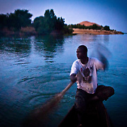 Rower crossing the Niger river from the Dune of Koima ( Dune Rose ), Gao region. Mali .West Africa.