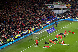 CARDIFF, WALES - Tuesday, November 19, 2019: Wales' players celebrate after a 2-0 victory ensures qualification to Euro 2020 after the final UEFA Euro 2020 Qualifying Group E match between Wales and Hungary at the Cardiff City Stadium. (Pic by Paul Greenwood/Propaganda)
