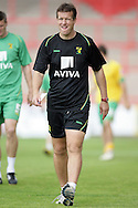 London - Saturday August 15th, 2009: Norwich City Caretaker Manager Ian Butterworth of Norwich City conducts the warm down after the Coca Cola League One match at St James Park, Exeter. (Pic by Mark Chapman/Focus Images)