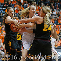 Oregon State's Marie Gulich, center fights Arizona State's Sophie Brunner, left, and Kelsey Moos for the ball in the second half of an NCAA college basketball game in Corvallis, Ore., on Monday, Feb. 1, 2016. Oregon State won 67-44. (AP Photo/Timothy J. Gonzalez)