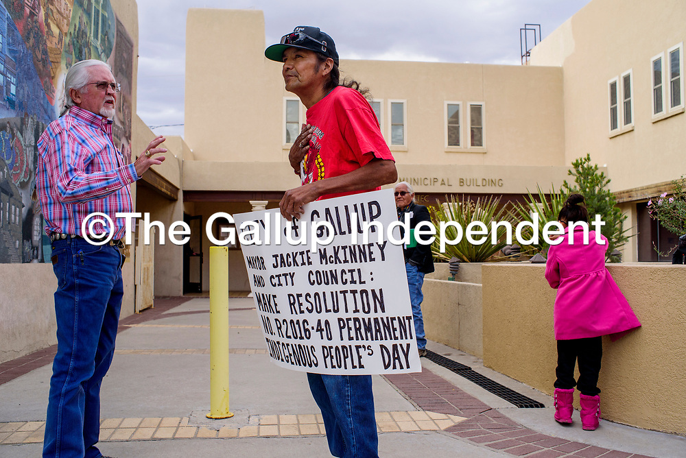 Gallup mayor Jackie McKinney, left, talks with activist Mervyn Tilden outside city hall before the start of the Gallup City Council meeting Tuesday.