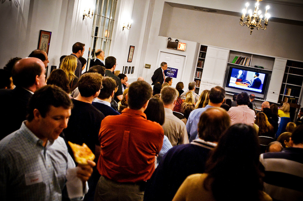 Young Republicans watching the first presidential debate between Obama and McCain at a debate watching party in the Young Republican clubhouse on Upper East Side in New York City.....Photographer: Chris Maluszynski /MOMENT
