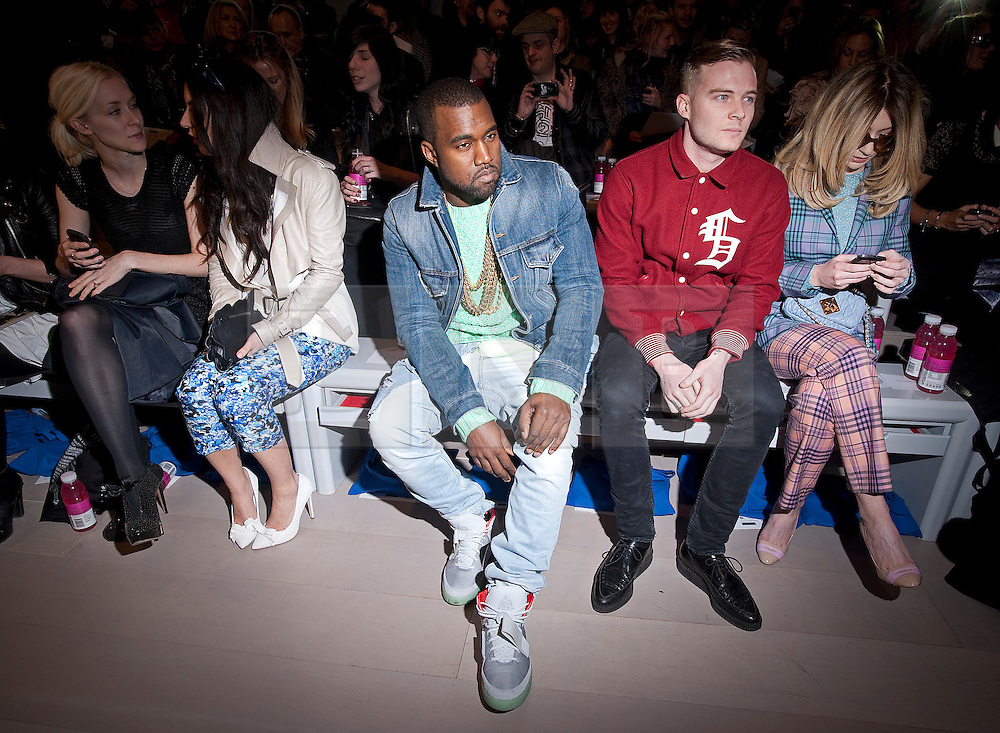 © Licensed to London News Pictures. 20/02/2012. London, UK.  American rapper, singer, and record producer Kanye West on the front row at Mark Fast Autumn/Winter 2012 collection on Day 4 of London Fashion Week 2012 at Topshop Show Space on February 20th, 2012. Photo credit : Ben Cawthra/LNP