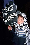 Roma  2004 .Manifestazione per la Palestina.Una bambino con la kefia con un cartello dove ? scritto: stop all'occupazione..Rome 2004.Demonstration for Palestine.A child with kafeeyah. The cartel reads: stop the occupation