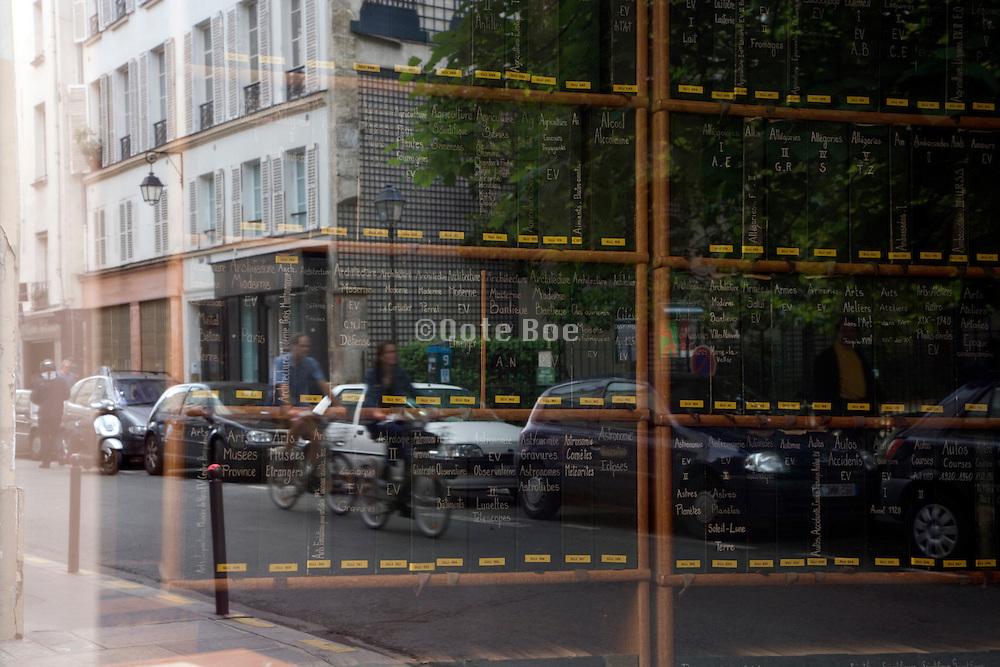 window reflection with old file cabinet Paris St. Germain des Pres Rue de Seine