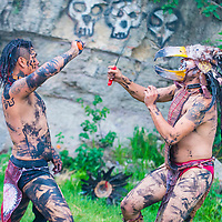 SAN MIGUEL DE ALLENDE , MEXICO - MAY 31 : Two Native Americans in a machete fight during the festival of Valle del Maiz on May 31 , 2015 in San Miguel de Allende ,Mexico.