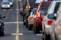 Traffic seemingly stacked on top of each other, wait for a signal light to change before proceeding.