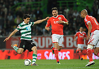 20120409: LISBON, PORTUGAL -Portuguese Liga Zon Sagres 2011/2012 - Sporting CP vs SL Benfica.<br /> In picture: Sporting's Matias Fernandez, from Chile, left, shoots the ball with Benfica's Javi Garcia, from Spain.<br /> PHOTO: Alvaro Isidoro/CITYFILES