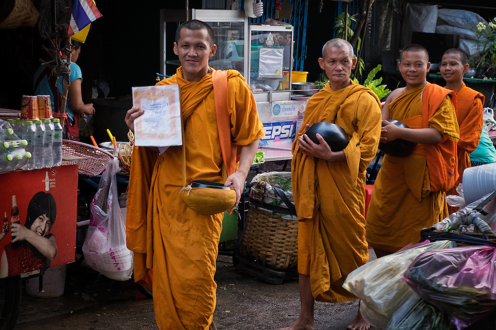 Monks solicit donations in the Khlong Toei market, ‪Bangkok‬, ‪Thailand‬.