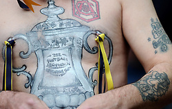 With the help of body paint and piercings an Arsenal fan displays the FA Cup in Arsenal colours on his chest   - Photo mandatory by-line: Joe Meredith/JMP - Mobile: 07966 386802 - 30/05/2015 - SPORT - Football - London - Wembley Stadium - Arsenal v Aston Villa - FA Cup Final
