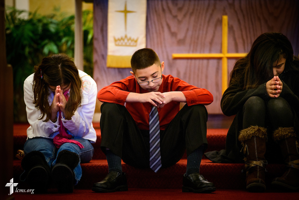 Erick Dominguez prays with other young adults during worship at La Iglesia Luterana San Pablo, the former original church building of St. Paul Evangelical Lutheran Church, on Sunday, April 10, 2016, in Columbus, Ind. LCMS Communications/Erik M. Lunsford