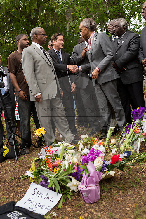 Rev. Al Sharpton greets Rev. Jeremy Rutledge before the start of a peace vigil at the spot where unarmed motorist Walter Scott was gunned down by police April 12, 2015 in North Charleston, South Carolina. About 100 people showed up for the brief vigil following a healing service at Charity Mission Baptist Church.