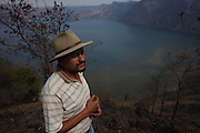 Oscar Morales, vice-president for the Committee in charge of the Community Consultation with regards to mining activity in San Rafael Las Flores, Guatemala, overlooks the Laguna de Ayarza, a volcanic lake, that sits 2.5 Kilometers downstream from Tahoe Resources' El Escobal, or San Rafael, silver mine. According to the local Committee in the Defense of Life, the lake runs the risk of contamination due to the company's industrial mining activities in San Rafael Las Flores. The Escobal mine, 60% owned by US-based Tahoe Resources and 40% by Canadian mining giant Goldcorp, has been operating since 2011 without having previously consulted the local residents - a violation to numerous international conventions. San Rafael Las Flores, Santa Rosa, Guatemala. March 28, 2012.