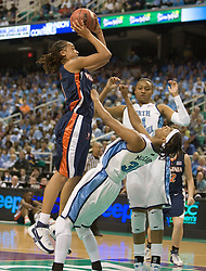 Virginia forward Lyndra Littles (1) is called for an offensive foul after running in to North Carolina guard/forward Rashanda McCants (32).  The #4 seed/#25 ranked Virginia Cavaliers women's basketball team fell to the #1 seed/#2 ranked North Carolina Tar Heels 80-65 in the semifinals of the 2008 ACC Women's Basketball Tournament at the Greensboro Coliseum in Greensboro, NC on March 8, 2008.